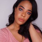 trending peach makeup look on dark skin