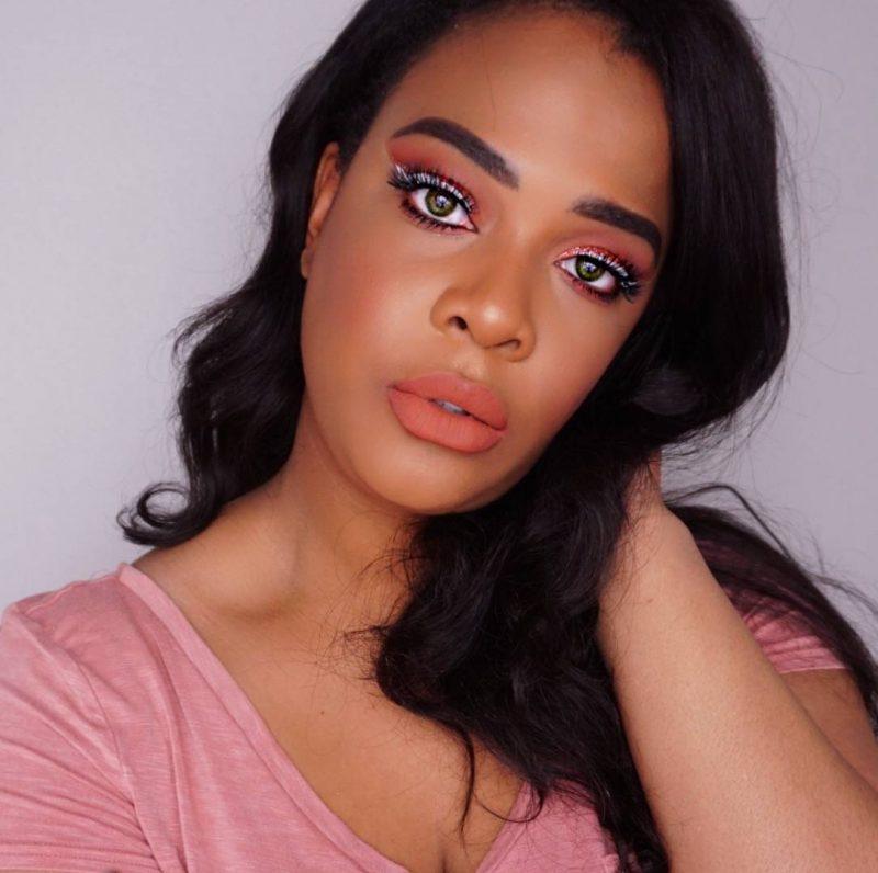 trending peach makeup look on dark skin